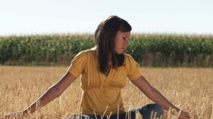 girl-in-sits-in-a-wheat-field-in-front-of-corn-4_-y2prqoes__D